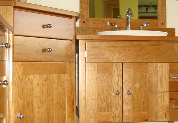 Detail of craftsman style cherry vanity